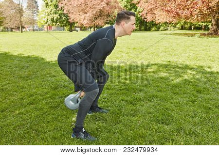 Man training with kettlebell for his bodybuilding crossfit fitness training