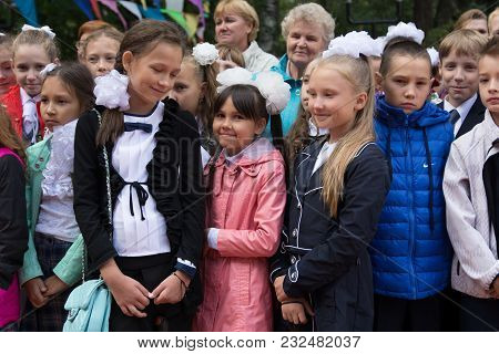 Yoshkar-ola, Russia - September 1, 2016 Schoolgirls In The City Line, Dedicated To The Beginning Of