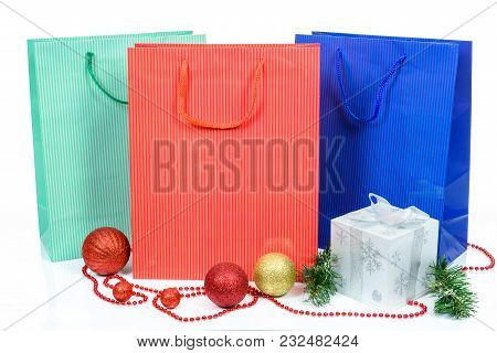 Concept Of Christmas Shopping And Gifts - Various Colored Shopping Bag And Christmas Decoration Isol