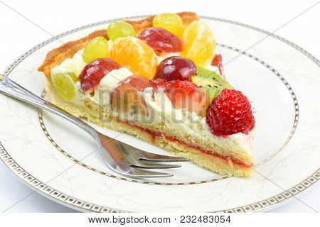 Fresh Homemade Multi Fruit Tart Cake On A Plate In Close-up.