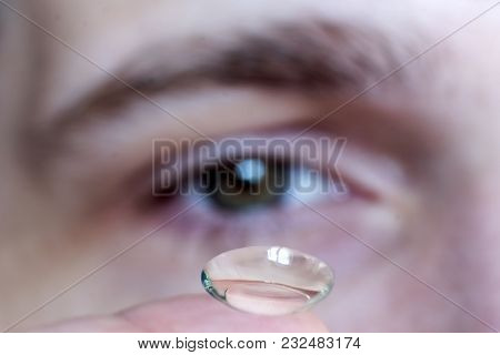 Male Eye Close-up, Contact Lens On Finger
