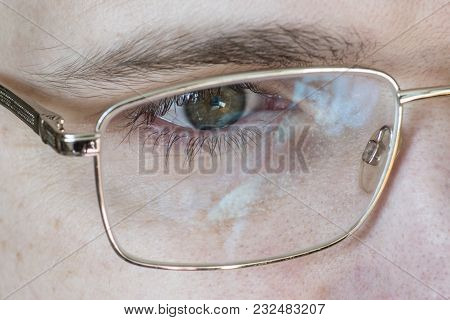 Close-up Of An Eye, Male Caucasian Face With Glasses