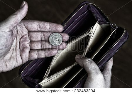 The Dirty Hands Of The Poor Man Hold One Quarter Of A Dollar And An Empty Wallet