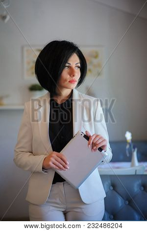 Beautiful  Business Lady  Working On A Tablet