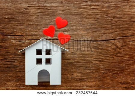 Miniature White Toy House With Red Hearts On A Rustic Old Vintage Wooden Background. Mortgage Proper