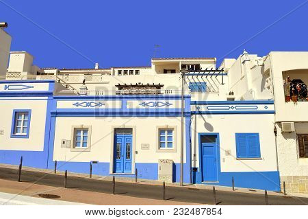 Albufeira, Algarve, Portugal - March 11, 2018 : Blue And White Houses Built On A Hill In Albufeira O
