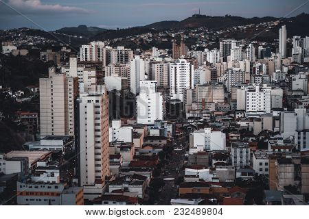 Close-up View From A High Point Of A Dark Evening Urban Landscape With The Street In The Center Of T