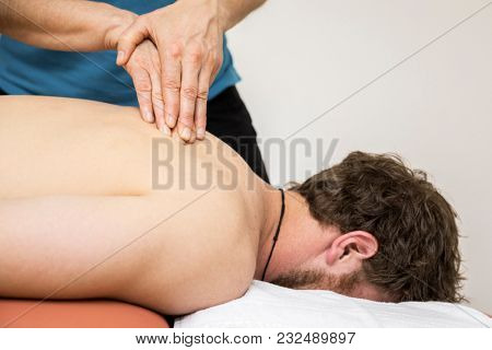 An image of a young man at the physio therapy