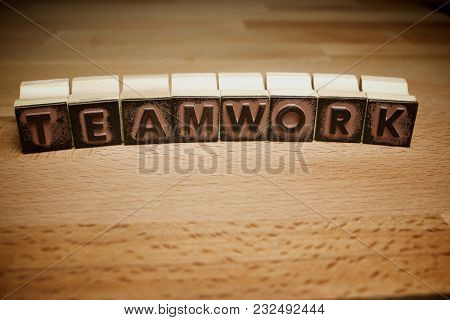 Rubber stamps creating the word teamwork.