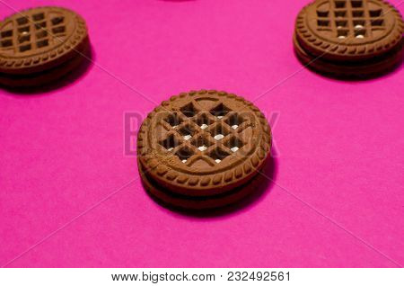 A Fresh Brown Biscuit Lies On A Pink Background. The Recipe For Sweet Food. Place For Text.