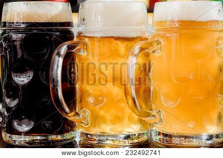Glasses Of Light And Dark Beer On A Bar Counter. Pub. Liter Glass
