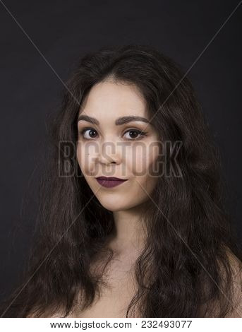 Portrait Of A Girl On A Dark Background.