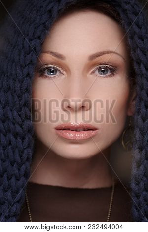 Close Up Portrait Of Middle Age Woman With Blue Scarf On Her Head.