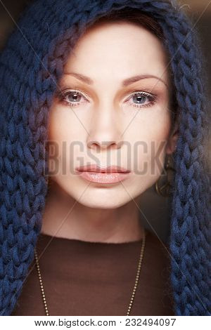 Portrait Of Middle Age Woman With Blue Scarf