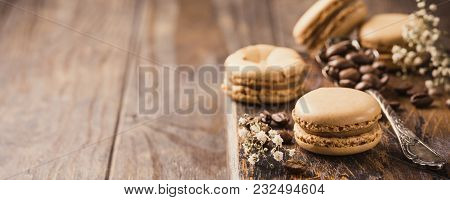 French Coffee Macarons With Ganache Filling With Coffee Beans On Old Wooden Board On Rvintage Backgr