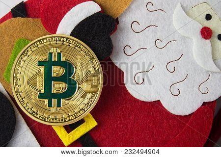 Santa Cloth Decoration Bag With Bitcoin Closeup Laying On A Table.