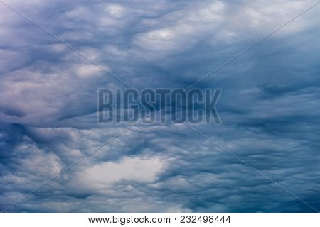 Dramatic Evening Sky With Blue Clouds