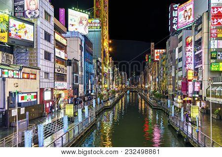 Osaka, Japan - April 29, 2014: Night View Of Dotonbori Canal. Dotonbori  Is One Of The Principal Tou