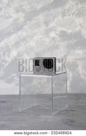 Action Camera On A Plastic Transparent Stand On A White Gray Background