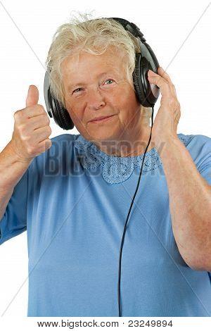 Senior Woman With Earphones Is Making Ok Gesture