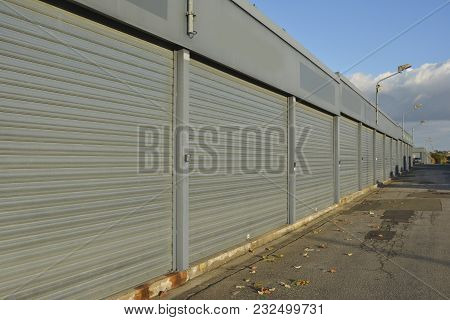 Row Of Gray Closed Containers Under The Open Sky