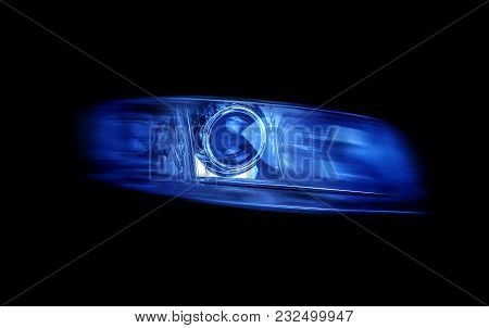 Modern Automotive Headlight On Black Background Shine Blue Light.