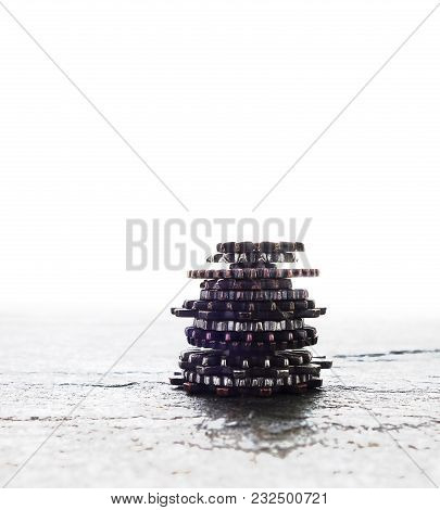 Metal Gears Stacked On A White Background