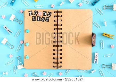 The Notepad On The Springs Is Open. Next To The Stationery. On The Brown Pages Of The Notebook There