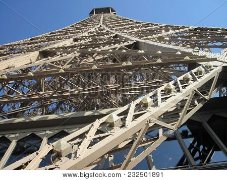 Openwork Metal Construction. View Of The Top Of The Eiffel Tower From The 2nd Floor. Paris, France.