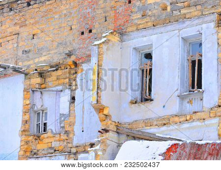 Earthquake disaster. Old destroyed house