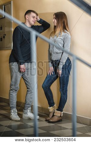 Adult Teenagers Boyfriend And Girlfriend Hugging Each Other In The Corridor Of An Apartment Building