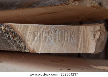 Folded Wooden Planks In A Sawmill. Piled Boards As Texture.