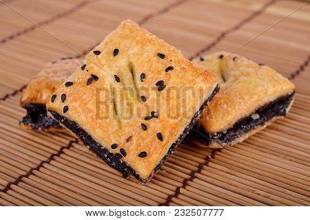 Crispy Pie With Black Sesame On Wooden Mat