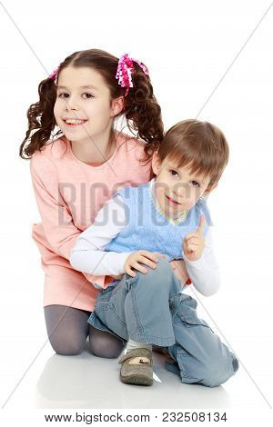 Brother And Sister Hugging Each Other. Boy And Girl Very Happy.isolated On White Background.