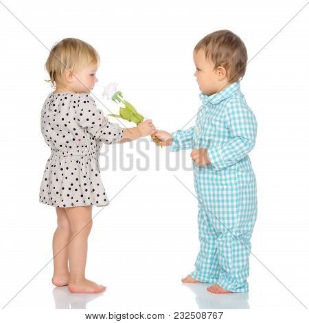 Toddler Boy And Girl, Cute Hugging In Studio On A White Background. The Concept Of A Harmonious Deve