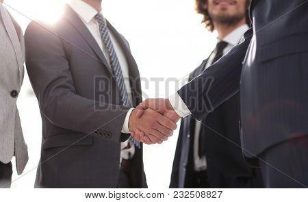 image of handshake of business partners.