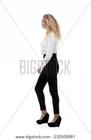 young employee walks forward.