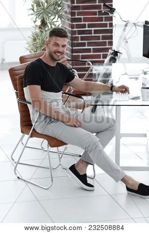 young designer sitting at his workplace