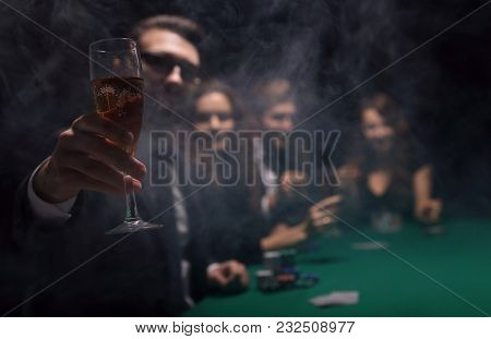 background image.poker players sitting at a table