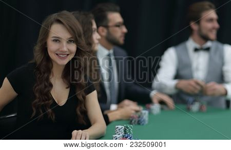 modern business woman sitting at craps table in a casino.