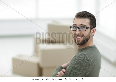 handsome man standing in new house
