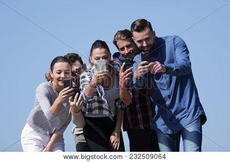 closeup. friends students make a selfie