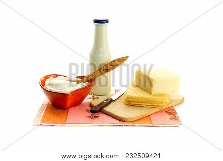 Dairy. Sour Cream In A Bowl, Cheese And Milk In A Bottle On A White Background Close-up.