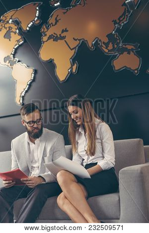 Two Business Colleagues Working In A Modern Office Building. Focus On The Woman