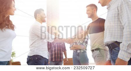 view from the top.handshake of businessmen