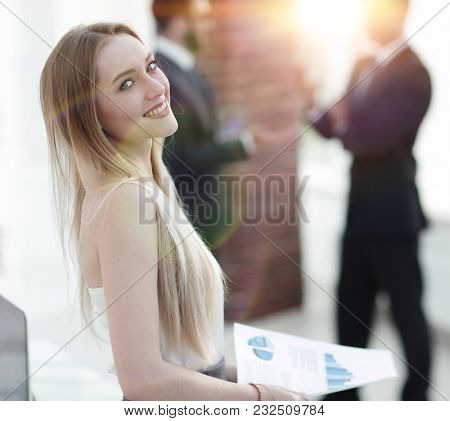 portrait of an elegant young business woman on the office background