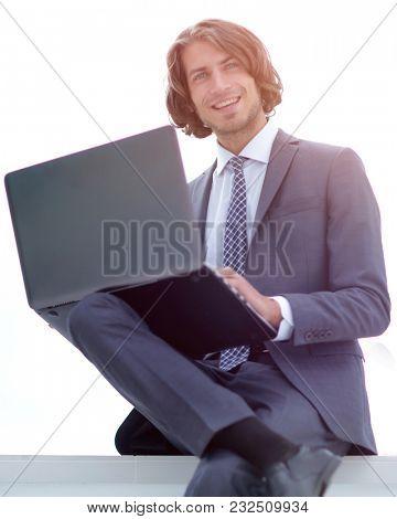 closeup.successful businessman working on a laptop