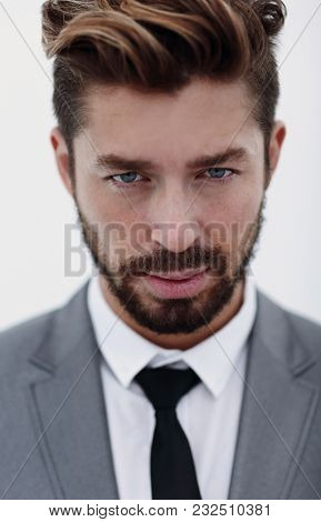 Serious businessman wearing suit and tie. blue background