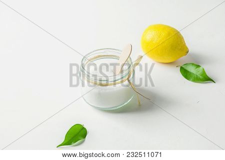 Ripe Yellow Lemon Green Citrus Leaves Sugar In Glass Jar. Ingredients For Face Scrub On White Concre