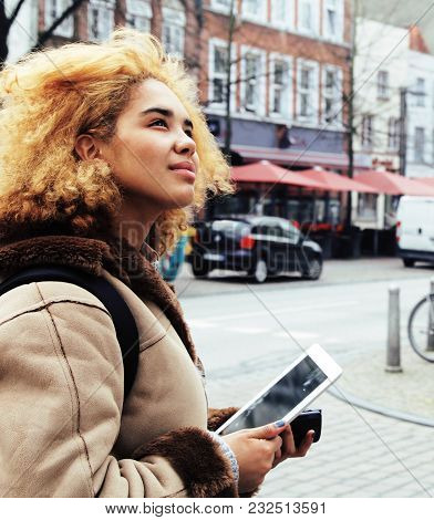 Young Pretty African American Girl With Curly Hair Making Photo On A Tablet, Lifestyle People Concep